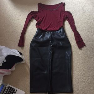 Black skirt with a cold shoulder long sleeve